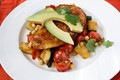 Ancho chicken with warm corn, zucchini and tomato salad
