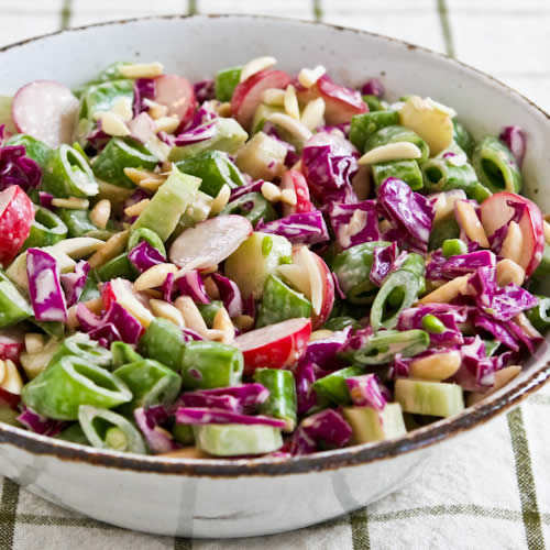... broccoli stems, sugar snap peas, radishes, red cabbage, and almonds
