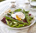 Asparagus salad with a runny poached egg