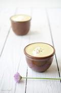 Asparagus soup with crème fraîche and chive blossoms