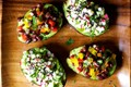 Avocado cup salads with black bean confetti