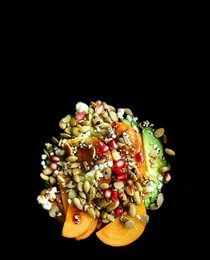 Avocado, persimmon, and pomegranate salad