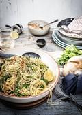 Baby pea, asparagus, prosciutto & kale spaghetti with lemon & macadamia pangrattato