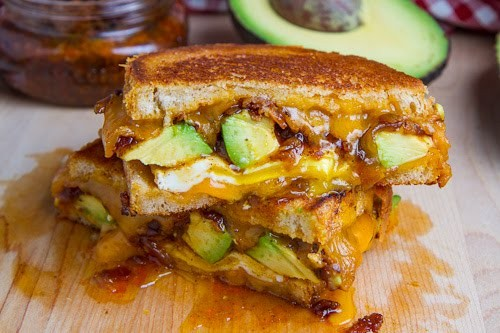 Bacon jam and avocado grilled cheese sandwich with fried egg