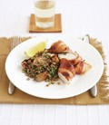 Bacon-wrapped chicken with dressed lentils