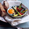 Baked duck egg with chorizo, piquillo peppers and new season's asparagus