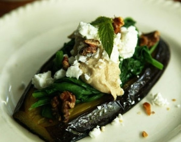 Baked eggplant with spinach, tahini and mint