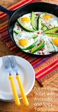 Baked eggs skillet with avocado and spicy tomatoes
