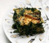 Baked matzo brei with mixed greens, mushrooms and smoked herring