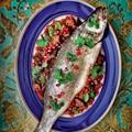 Baked sea bass with aubergine, walnuts & pomegranates