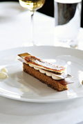 Banana mille-feuille date cake soaked in rum sauce, vanilla/parsnip puree, coco/banana wafers