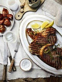 Barbecued T-bones with herb oil and Taleggio onions