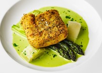 Breaded hake, asparagus and wild garlic sauce