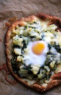 Breakfast pizza with hash browns, spinach, and eggs