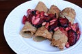 Buckwheat pancakes with plums, almonds and honey