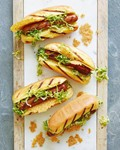Caesar salad hot dogs