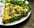 Carrot top frittata with spinach, ham and Asiago