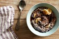Cashew milk red quinoa porridge with spice, fruit, and maple