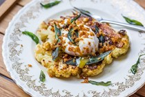 Cauliflower steaks with yeasted hazelnut crumble, crisped sage & a poached egg