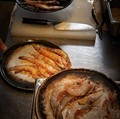 Charcoal-oven roasted king prawns