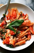 Cheesy pasta with tomato cream sauce