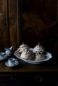 Chocolate meringue swirls with chocolate sauce with crème Chantilly
