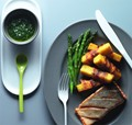 Crispy skin salmon with polenta chips wrapped in pancetta served with asparagus and gremolata