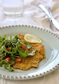 Flounder Milanese with arugula and tomatoes