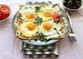 Fried eggs with garlic yogurt sauce, Iranian style (Gozlemeh)