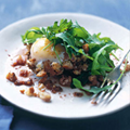 Fried eggs with rocket and torn bread
