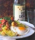 Frisée salad with lardons and poached egg