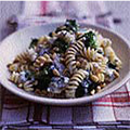 Fusilli with steamed green vegetables, nuts and blue cheese