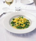 Goat's cheese tortellini with broad bean and pea butter