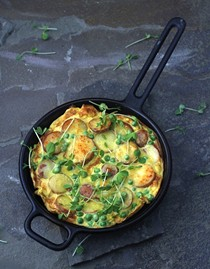 Golden frittata with potatoes, peas, and Parmesan
