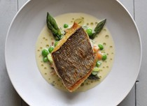 Grilled bream with mustard and tarragon sauce, asparagus and peas
