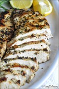 Grilled chicken breasts with herbs and lemon