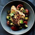 Grilled cilantro chicken with pickled tomato and avocado salsa
