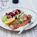 Grilled fish fillets with a salad of cucumber, celery, dates, roasted red capsicums & walnuts