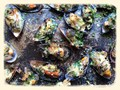 Grilled mussels with persillade and Parmesan