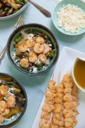 Grilled shrimp and veggie quinoa bowls with garlic mojo