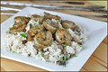 Grilled shrimp with brown buttered rice and mushrooms