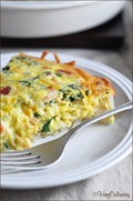 Hash brown-crusted quiche with bacon and kale