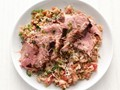 Herb-crusted pork tenderloin with tomato rice