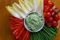 Holiday vegetable platter with herbed avocado dip