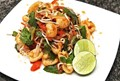 Issan-style spicy Thai fried pork rind and herb salad