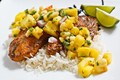 Jerk fish on coconut rice topped with banana and pineapple salsa