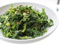 Kale salad with glazed pumpkin seeds and hot cider vinaigrette from 'The New Vegetarian Cookbook for Everyone' (Cook the Book)
