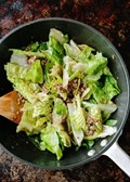 Lettuce salad with hot beef dressing