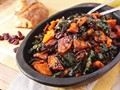 Make ahead roasted squash and kale salad with spiced nuts, cranberries, and maple vinaigrette