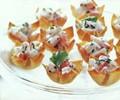 Mango-curry shrimp salad in wonton cups